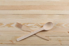 Wooden spoon and fork on wooden boards Stock Images