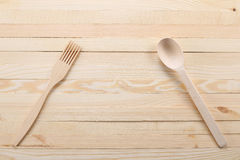 Wooden spoon and fork on wooden boards Royalty Free Stock Photo