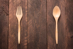Wooden spoon and fork on wooden table Royalty Free Stock Photography