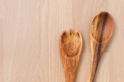 Wooden spoon and fork on wooden table background. Wooden spoon and fork kitchenware Royalty Free Stock Photos