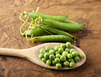 Wooden spoon with fresh peas Royalty Free Stock Photo