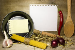 Wooden spoon, frying pan royalty free stock photos