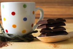 Wooden spoon full of chocolate bars Stock Images
