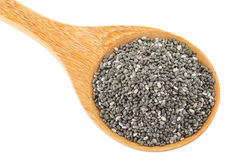A wooden spoon full of dried Chia seeds royalty free stock photography