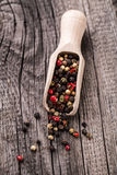 Wooden spoon full of mix pepper Stock Photo