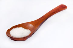 Wooden spoon full with the sugar Royalty Free Stock Photography