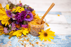 Wooden spoon in glass with pollen. On the table stock photo