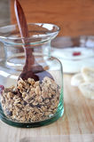Wooden spoon in granola bottle Stock Images