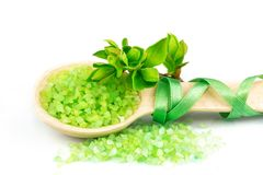 Wooden spoon with green bath salt Royalty Free Stock Image