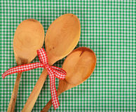 Wooden spoon on green napkin Stock Photo