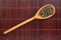 Wooden spoon with green  tea Stock Images