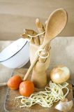 Wooden spoon in hand Royalty Free Stock Images