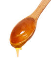 Wooden spoon with honey isolated Royalty Free Stock Photo
