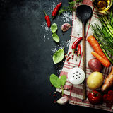 Wooden spoon and ingredients. On dark background. Vegetarian food, health or cooking concept stock photos