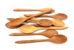 Wooden spoon isolated on white background. Wooden tea spoon isolated. Wood spoon isolated.Wood tea spoon isolated. Background stock photo