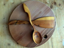 Wooden spoon, kitchen spatula made of Karelian birch. Handmade. Russian folk crafts. Vaalam. Closeup Stock Photo