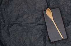 Wooden spoon and kitchen towel on tissue paper royalty free stock photos