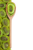 Wooden spoon with kiwi Stock Photos