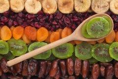 Wooden spoon with kiwi Stock Photos