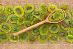 Wooden spoon with kiwi Stock Image