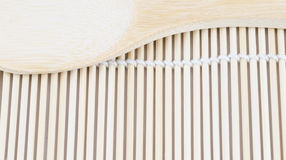 Wooden spoon on the making sushi bamboo mat Stock Photography