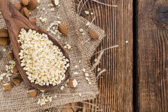 Wooden Spoon with Minced Almonds Royalty Free Stock Image