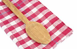 Wooden spoon on a napkin Stock Photo