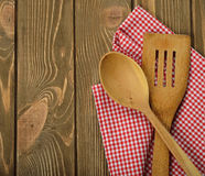 Wooden spoon and napkin Stock Images