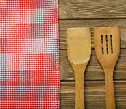 Wooden spoon and napkin Royalty Free Stock Photography