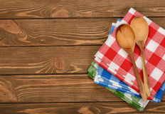 Wooden spoon and napkin Royalty Free Stock Photo