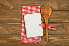 Wooden spoon and napkin Royalty Free Stock Images