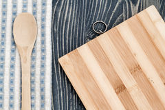 Wooden Spoon on Napkin, Chopping Board and Blue Wooden Backgroun Stock Photo