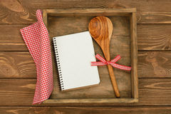 Wooden spoon and notebook Stock Image
