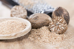 Wooden spoon with Nutmeg Powder Royalty Free Stock Photo