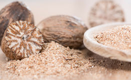 Wooden spoon with Nutmeg Powder Royalty Free Stock Photography