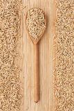 Wooden spoon with oats Stock Photos