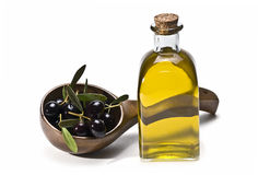Wooden spoon with olives and oil. Stock Images