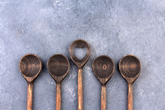 Wooden spoon over textured background, from above Stock Image