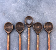 Wooden spoon over textured background, from above Stock Photos