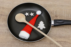 Wooden spoon and pan Stock Photos