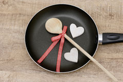 Wooden spoon and pan Royalty Free Stock Photo