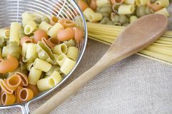 Wooden spoon with pasta Stock Photos