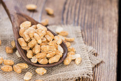 Wooden spoon with Peanuts Royalty Free Stock Images