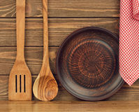 Wooden spoon, plate and napkin Royalty Free Stock Image