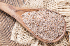Wooden Spoon with Psyllium Stock Images