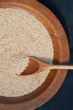 Wooden spoon and quinoa grains Stock Photography