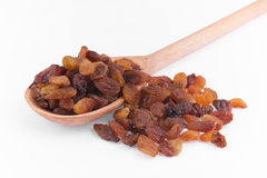 Wooden spoon with raisins Stock Images