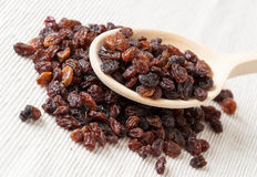 Wooden spoon with raisins Royalty Free Stock Photos