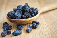 Wooden spoon with raisins Stock Photography