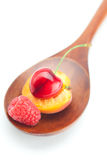Wooden spoon,raspberry, cherries and apricots Stock Image